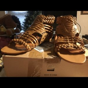 Sandals in Black and Tan never worn leather uppers